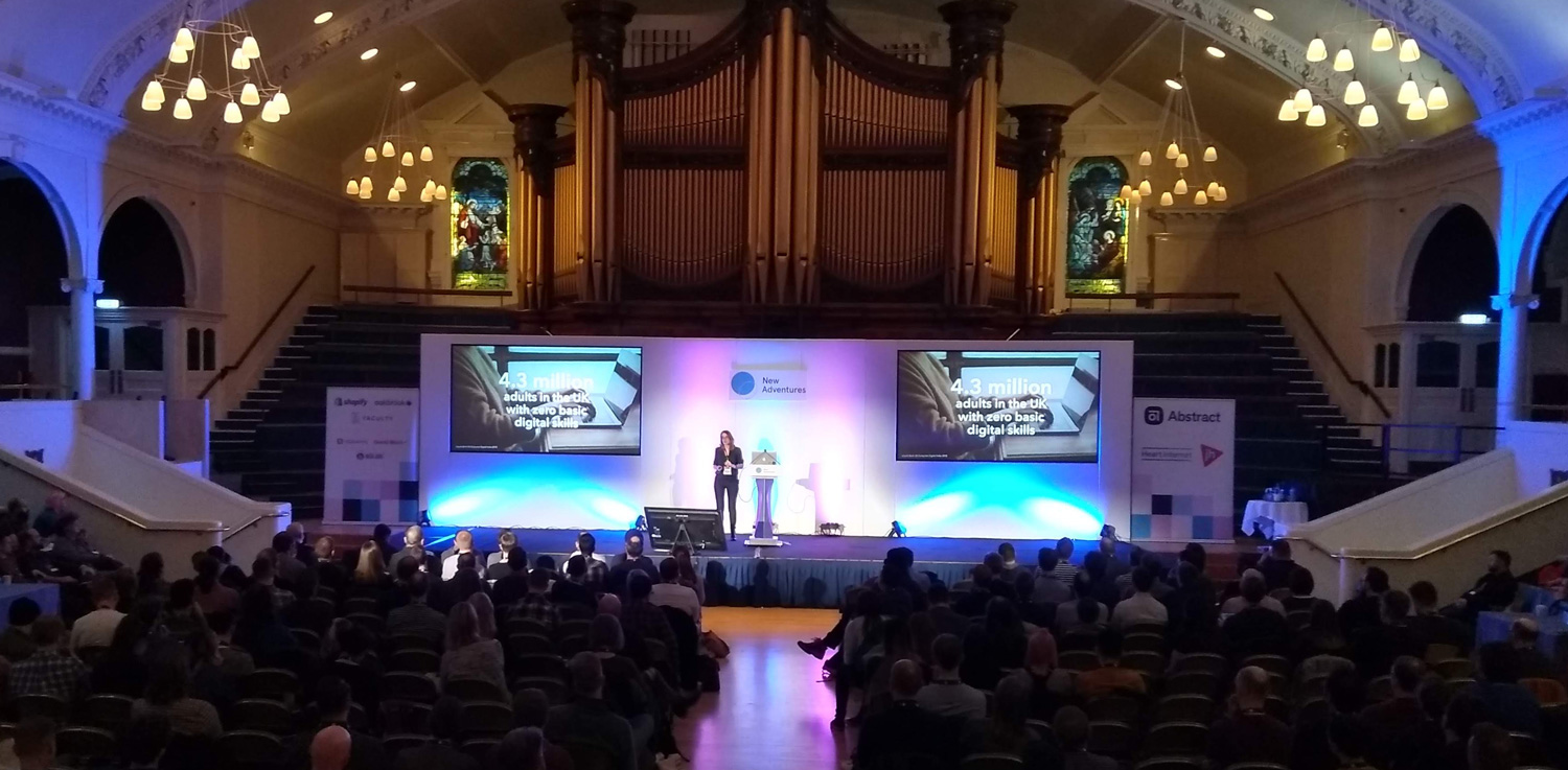 Helen Joy speaking in front of audience at New Adventures Conference 2019