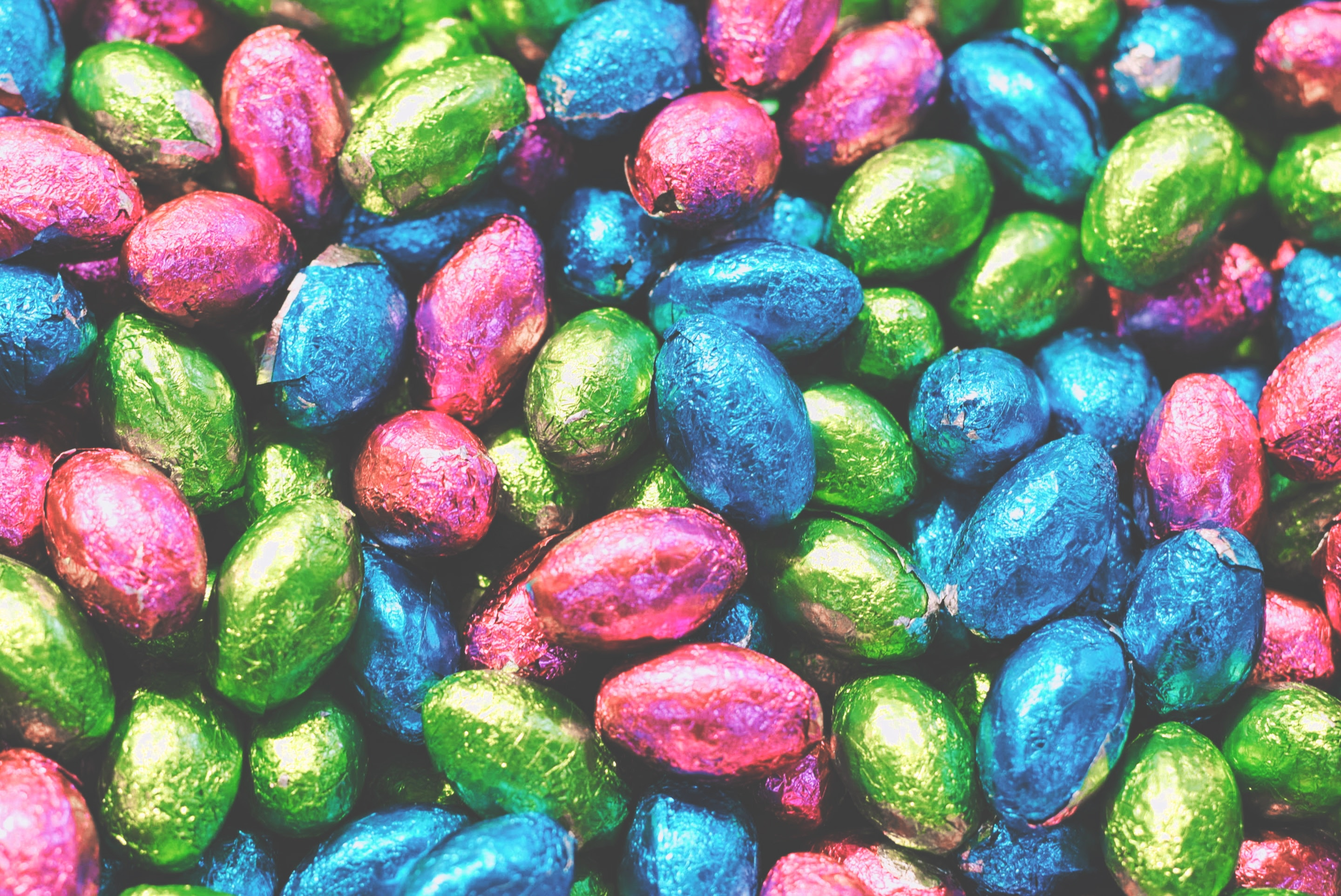 A collection of multi coloured easter eggs in foil.