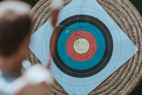 An archer aiming at a target.
