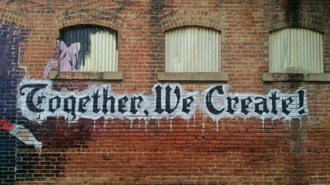 """Street art that reads """"Together we create!""""."""
