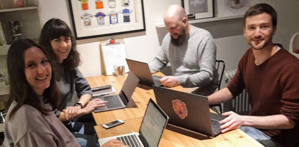 Paul Jardine and three attendees sat at a table for the Beginner's Guide to SEO workshop
